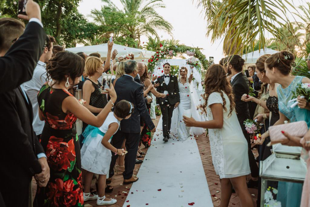wedding confetti throwing in Christian Wedding in Sicily