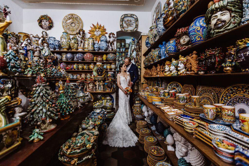 Coastal Wedding in Taormina, Sicily, bride and groom, couple portrait into ceramic shop