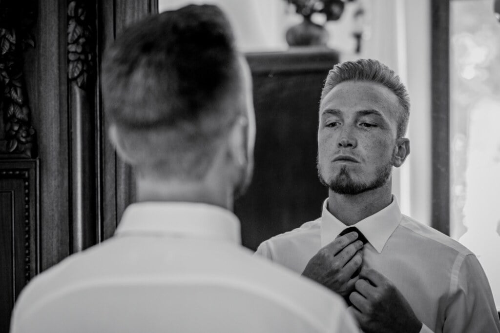 Groom getting ready in Evangelical Christian Wedding
