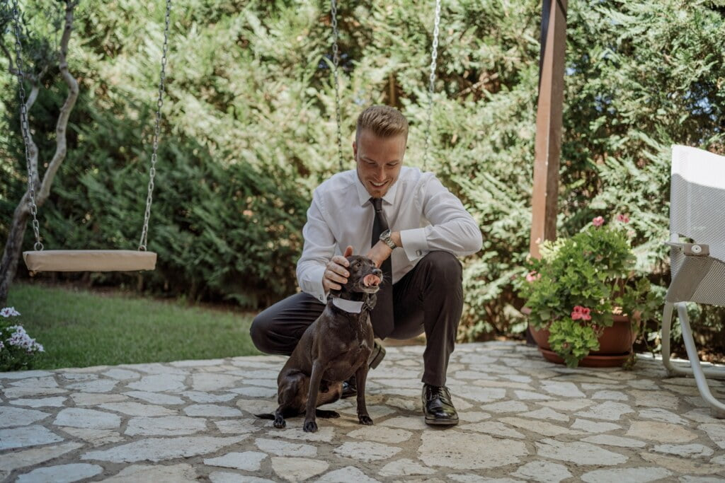 Groom and dog in Evangelical Christian Wedding