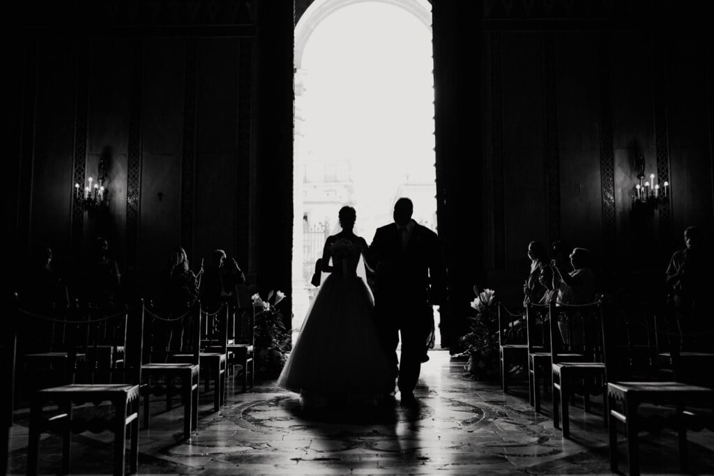 Entrance to the church in elegant destination wedding in Sicily