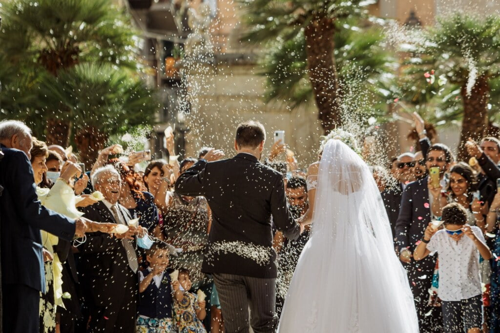 Wedding confetti throwing  in elegant destination wedding in Sicily