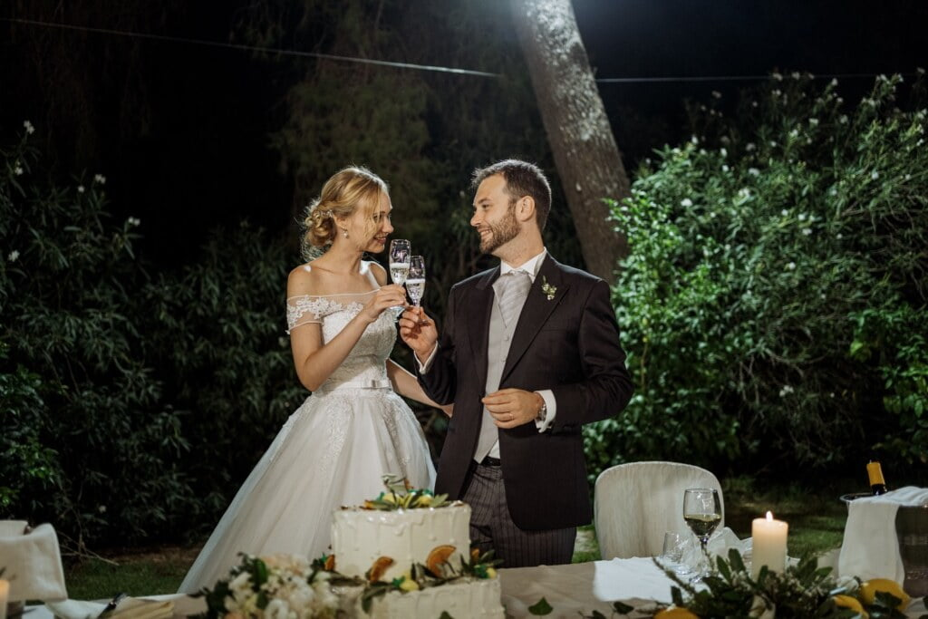 Toast in elegant destination wedding in Sicily