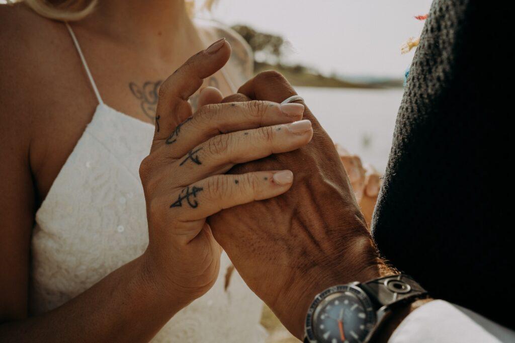 focus hands wedding lake sicily Italy